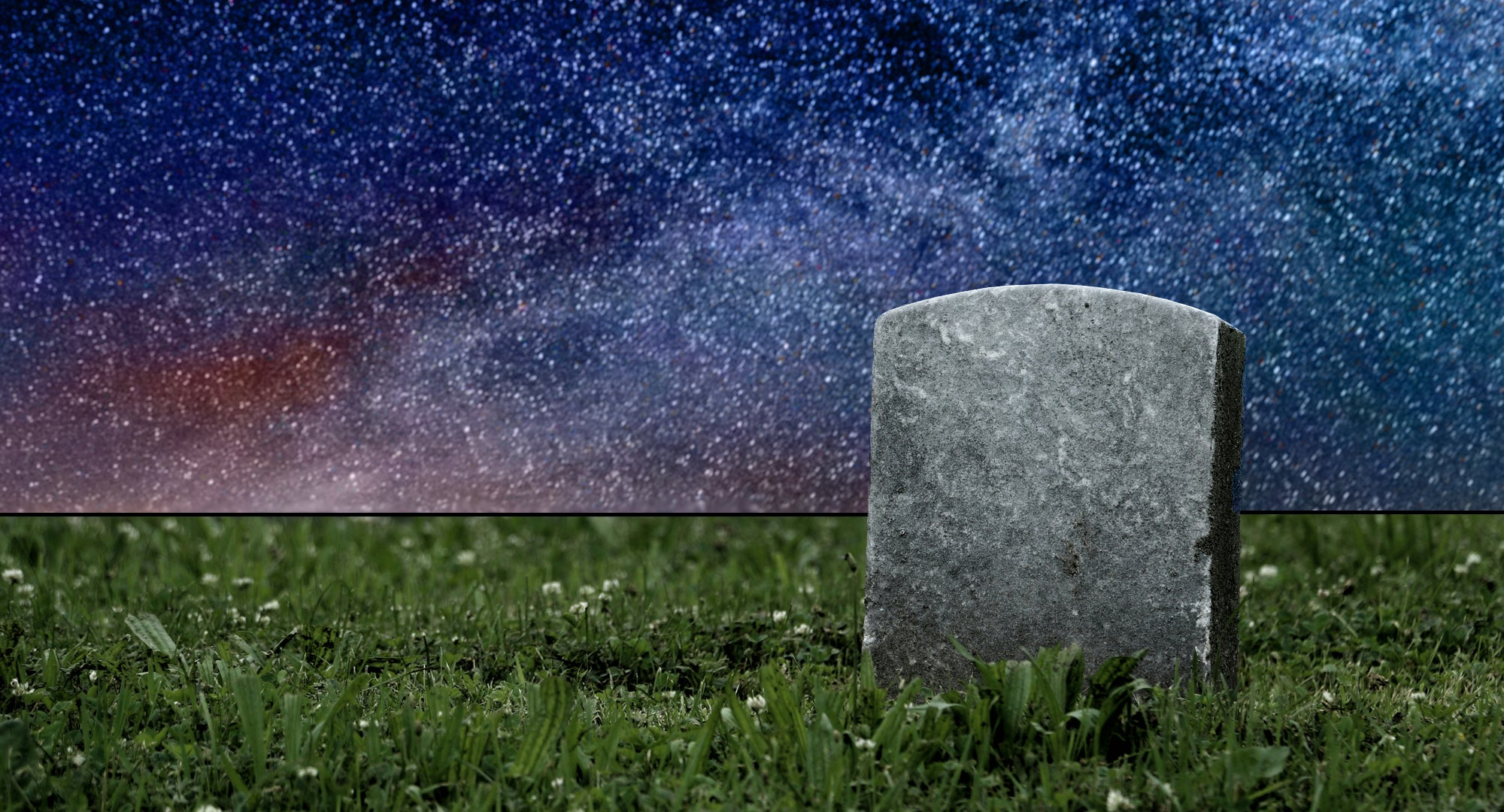 A tombstone surrounded by stars and grass.