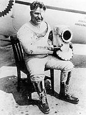 Wiley Post sits in the third version his pressure suit.