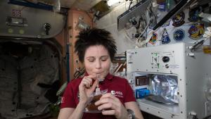 ESA (European Space Agency) astronaut Samantha Cristoforetti enjoys her first drink from the new ISSpresso machine. The espresso device allows crews to make tea, coffee, broth, or other hot beverages they might enjoy.