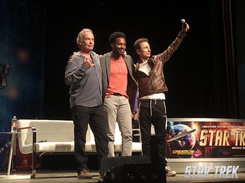 Anthony Montgomery, Gary Graham, and Dominic Keating greet the crowd seated for the Enterprise panel