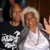 Nichelle Nichols signs for fans on the vendor floor
